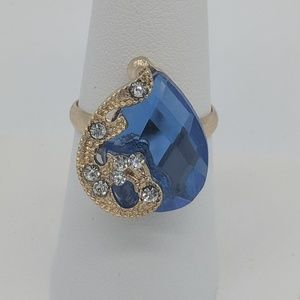 Blue and gold stone ring